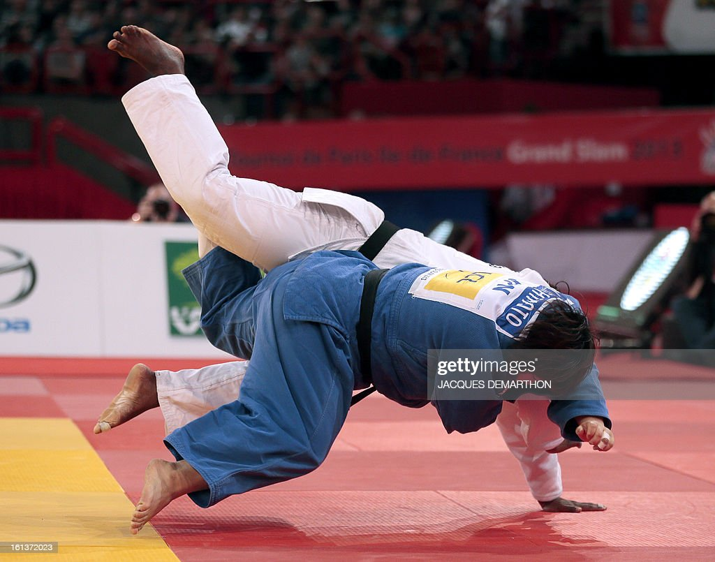 Japan's Tachimoto Migumi (blue) competes with Cuba's Idalys Ortiz (white) during the Final of the Women +78kg category of the Paris Judo Grand Slam tournament, at the Palais Omnisports de Paris-Bercy (POPB) in Paris, on February 10, 2013.