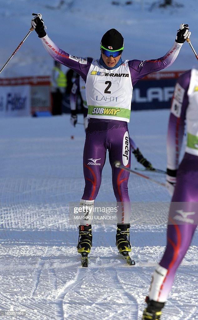 Japan's Taihei Kato celebrates as he crosses the finish line to place third in the Nordic Combined individual Gundersen 10 km cross country skiing event at the Lahti Ski Games, FIS World Cup event, in Lahti, on March 8, 2013. AFP PHOTO / LEHTIKUVA / Markku Ulander FINLAND OUT