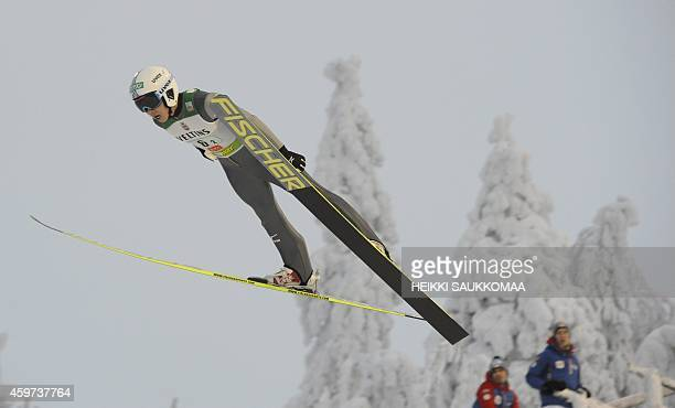 Japan's Taihei Kato soars through the air during the Nordic Combined team sprint's ski jumping competition at the FIS World Cup Ruka Nordic Opening...