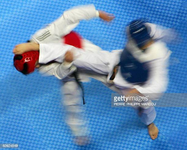 Japan's Takahino Niimi fights against Uruguay's Daniel Lee during their men's under 72 kg preliminary match at the Taekwondo World Championships in...