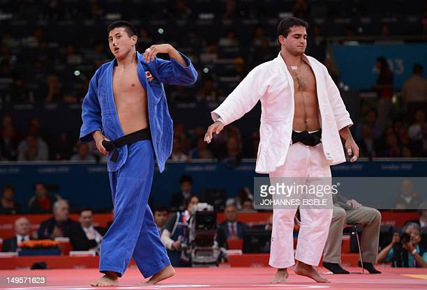 Japan's Takahiro Nakai and Brazil's Leandro Guilheiro reacts after their men's 81kg judo contest repechage match of the London 2012 Olympic Games on...