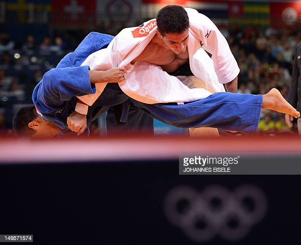 Japan's Takahiro Nakai competes with Brazil's Leandro Guilheiro during their men's 81kg judo contest repechage match of the London 2012 Olympic Games...