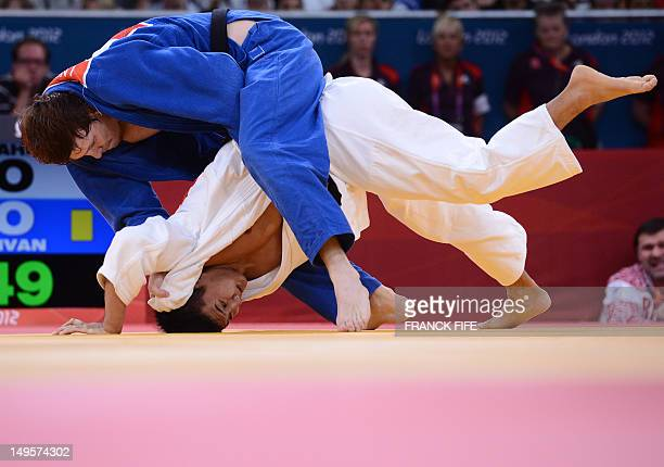 Japan's Takahiro Nakai competes with Russia's Ivan Nifontov during their men's 81kg judo contest bronze medal match of the London 2012 Olympic Games...