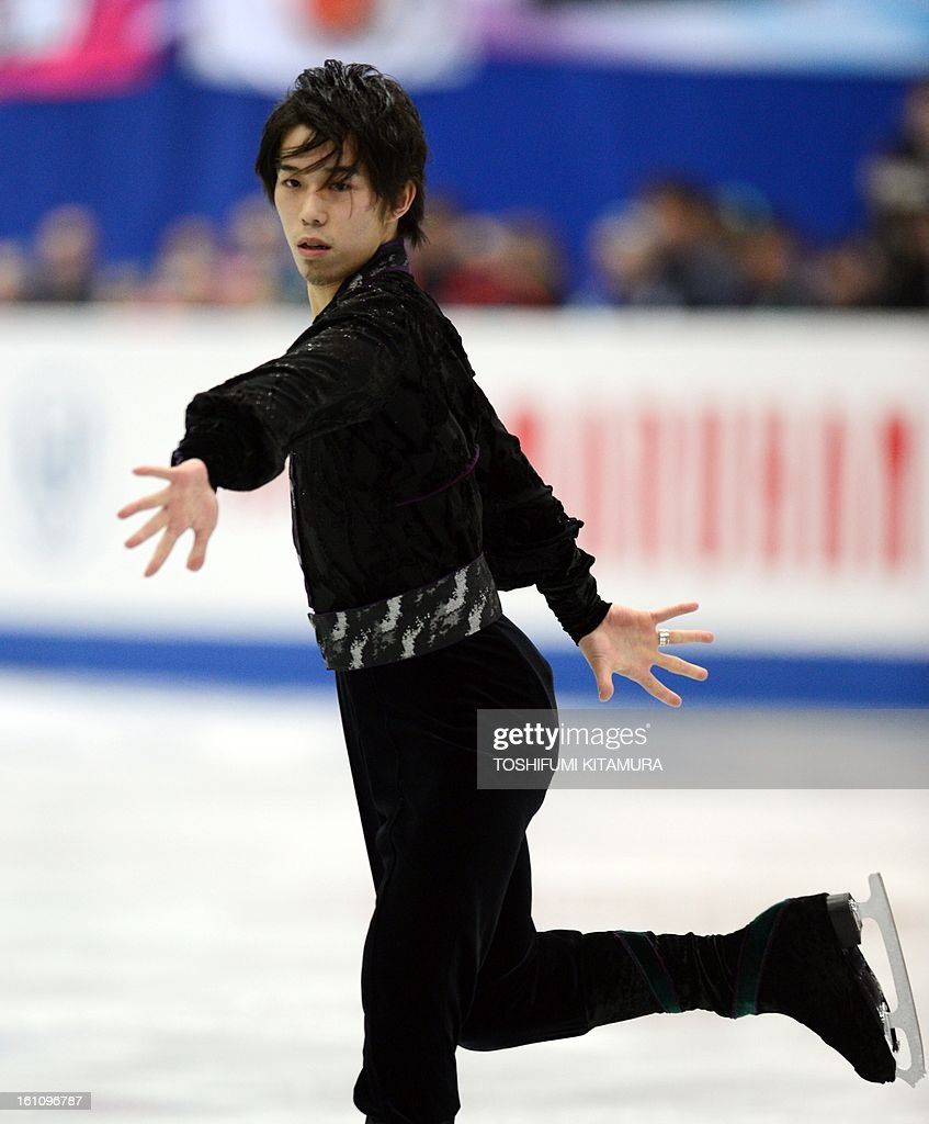 Japan's Takahito Mura performs his free skating in the men's event during the Four Continents figure skating championships in Osaka on February 9, 2013. AFP PHOTO / TOSHIFUMI KITAMURA