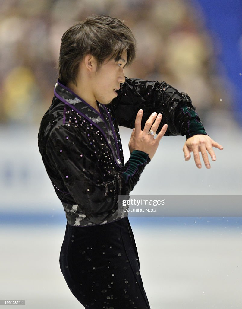 Japan's Takahito Mura performs in the men's free skating at the World Team Trophy figure skating competition in Tokyo on April 12, 2013. AFP PHOTO / KAZUHIRO NOGI