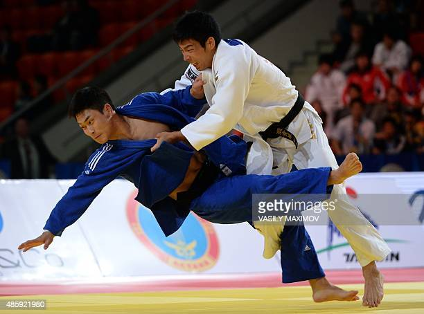 Japan's Takanori Nagase competes with South Korea's Lee Seungsu during the men's team gold medal match at the Judo World Championships in Astana on...