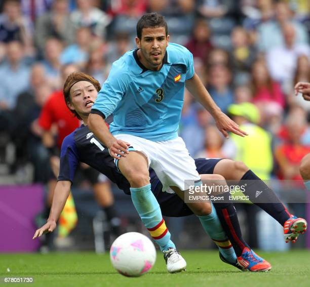 Japan's Takashi Usami and Spain's Alvaro Dominguez during the Spain v Japan Mens Football First Round Group D match at Hampden Park Glasgow