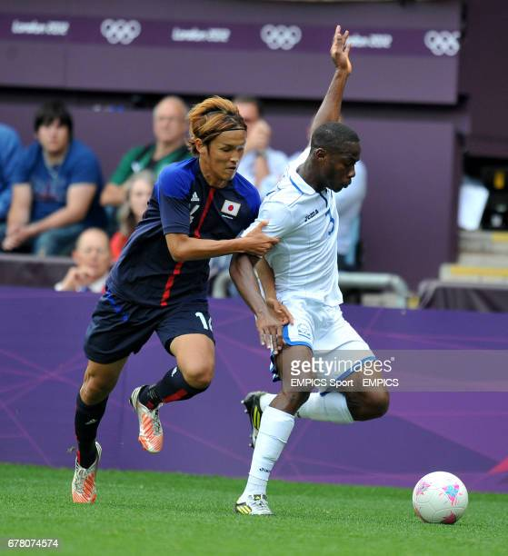 Japan's Takashi Usami holds onto Honduras' Maynor Figueroa during a Group D match at the London 2012 Olympics
