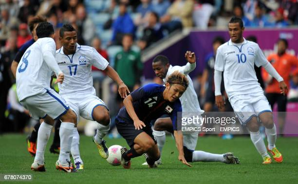 Japan's Takashi Usami is stopped by Honduras' Alfredo Mejia Luis Garrido Jos Velasquez and Alexander Lopez during a Group D match at the London 2012...