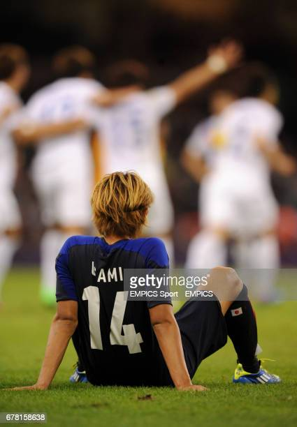 Japan's Takashi Usami sits dejected after the men's football Bronze medal match between Japan and South Korea at the Millennium Stadium