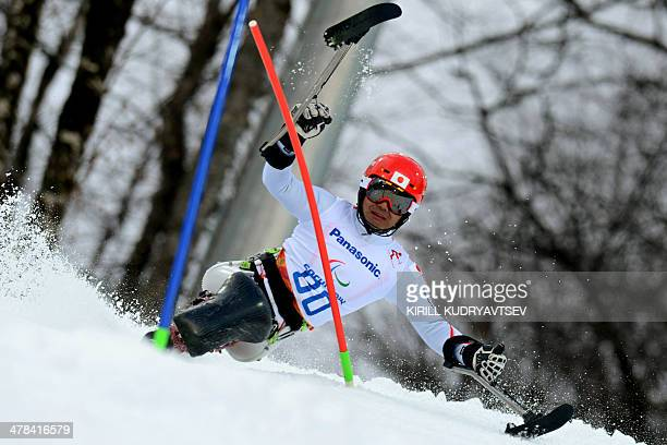 Japan's Takeshi Suzuki competes in the men's Alpine Skiing Slalom Sitting event during the XI Paralympic winter games at the Rosa Khutor Alpine...