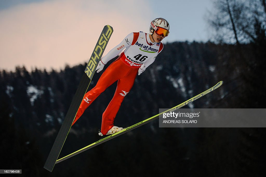 Japan's Taku Takeuchi soars through the air on February 27, 2013 during the Large Hill Individual qualification race of the FIS Nordic World Ski Championships at the Ski Jumping stadium in Predazzo, northern Italy.