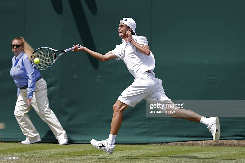 Japan's Taro Daniel returns against Argentina's Juan Monaco during their men's singles first round match on the second day of the 2016 Wimbledon Championships at The All England Lawn Tennis Club in Wimbledon, southwest London, on June 28, 2016. / AFP / ADRIAN