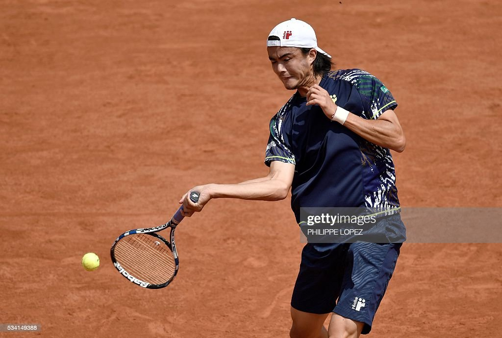 Japan's Taro Daniel returns the ball to Switzerland's Stanislas Wawrinka during their men's second round match at the Roland Garros 2016 French Tennis Open in Paris on May 25, 2016. / AFP / PHILIPPE