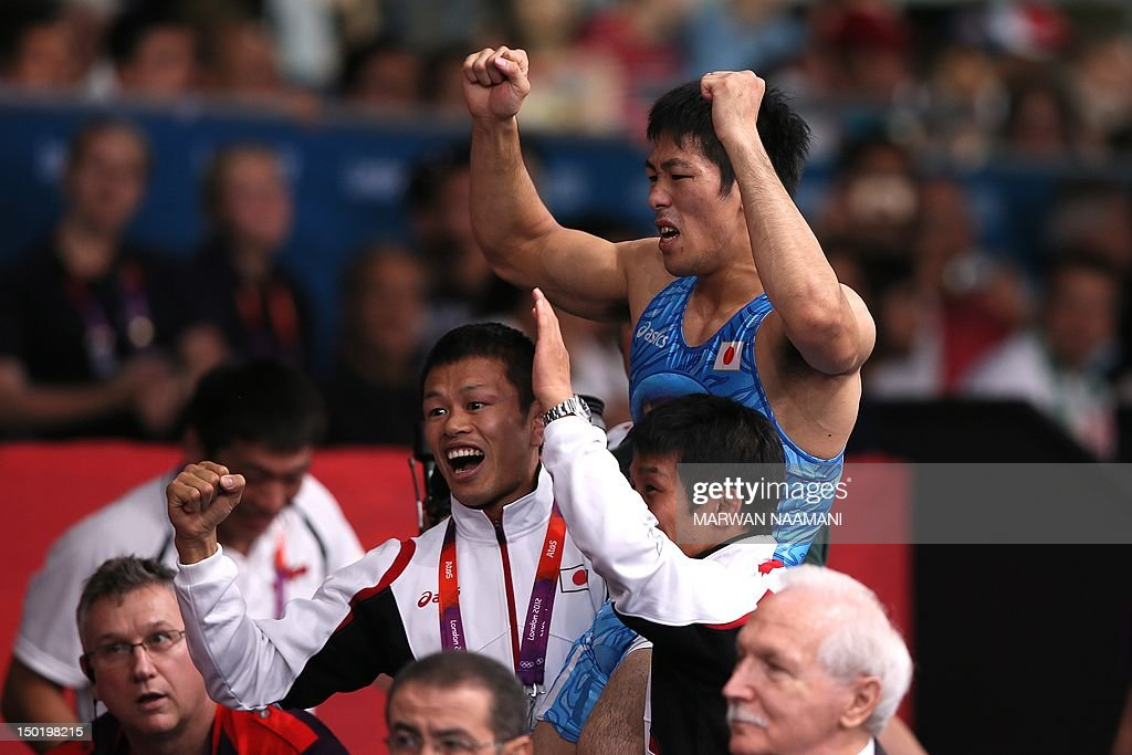 Japan's Tatsuhiro Yonemitsu celebrates after defeating India's Sushil Kumar in their Men's 66kg Freestyle gold medal match on August 12 2012 during...