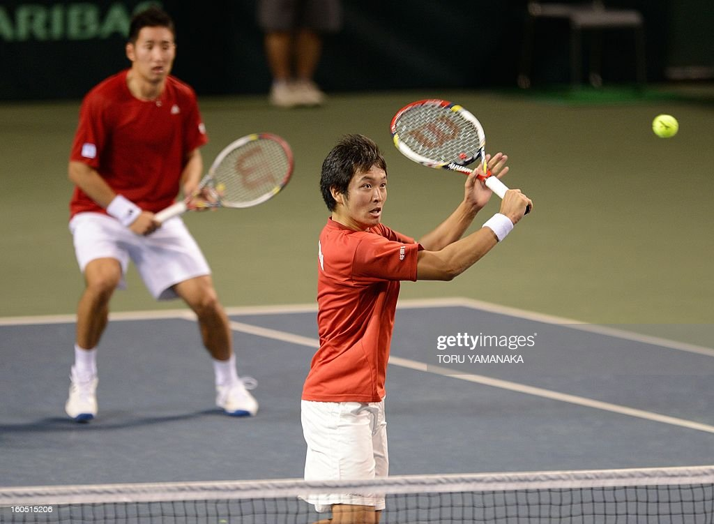 Japan's Tatsuma Ito (R) returns a shot beside his partner Yasutaka Uchiyama (L) to Indonesia's Christopher Rungkat and Elbert Sie during their men's doubles tennis match at the Davis Cup Asia-Oceania Zone Group I first-round tie on February 2, 2013. AFP PHOTO/Toru YAMANAKA