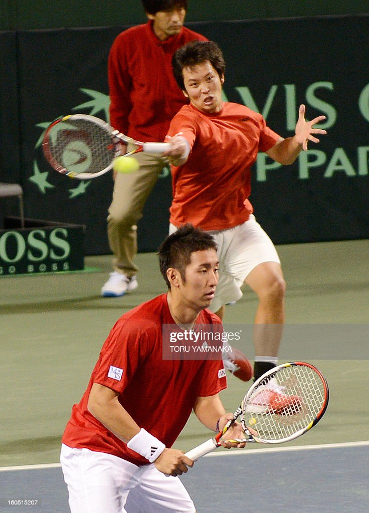 Japan's Tatsuma Ito (top) returns a shot beside his partner Yasutaka Uchiyama (front) to Indonesia's Christopher Rungkat and Elbert Sie during their men's doubles tennis match at the Davis Cup Asia-Oceania Zone Group I first-round tie on February 2, 2013. AFP PHOTO/Toru YAMANAKA
