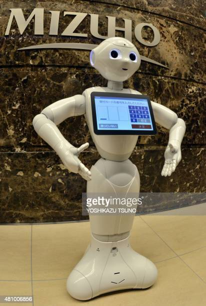 Japan's telecom giant Softbank's humanoid robot Pepper 'waits' for customers at the Mizuho Bank headquarters in Tokyo on July 17 2015 The Japanese...