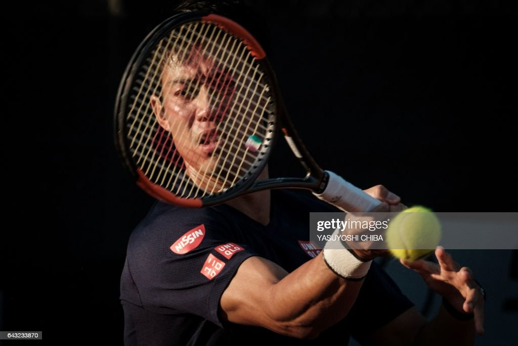 Japan's tennis player Kei Nishikori trains ahead of the 2017 ATP World Tour 500 Rio Open in Rio de Janeiro, Brazil, on February 20, 2017 Nishikori, number five in the ATP ranking, will face Brazil's Thomaz Bellucci Tuesday. / AFP PHOTO / Yasuyoshi Chiba