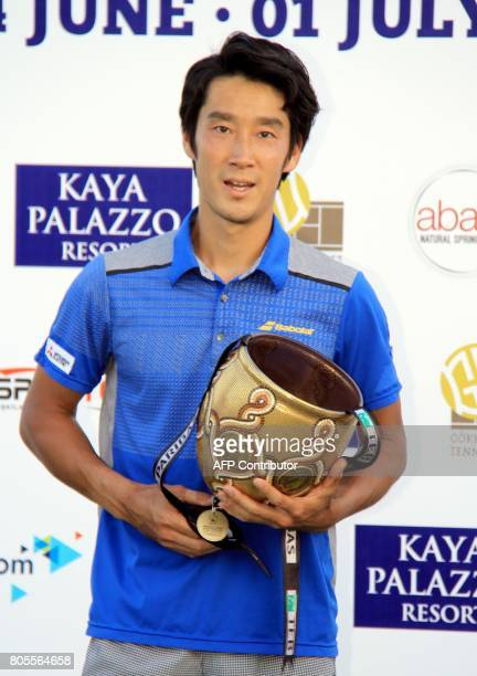 Japan's tennis player Yuichi Sugita poses with his trophy after winning the men's final match against French player Adrian Mannarino during the ATP...