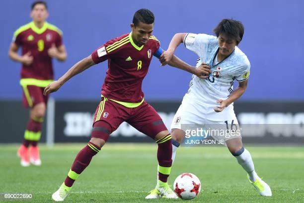 Japan's Teruki Hara fights for the ball with Venezuela's Yangel Herrera during their U20 World Cup round of 16 football match between Venezuela and...