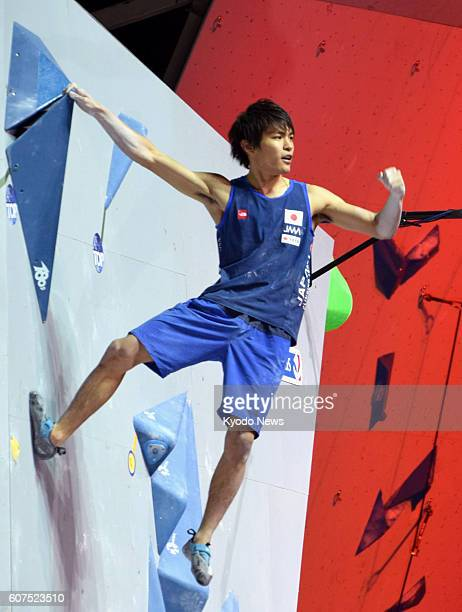 Japan's Tomoa Narasaki celebrates his completion of a bouldering problem during the D4 men's bouldering classification final at the IFSC Climbing...