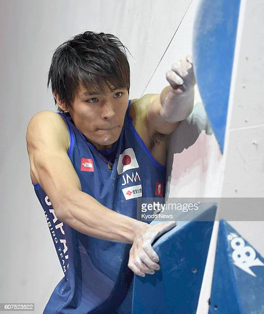 Japan's Tomoa Narasaki competes during the D4 men's bouldering classification final at the IFSC Climbing World Championships at the AccorHotels Arena...