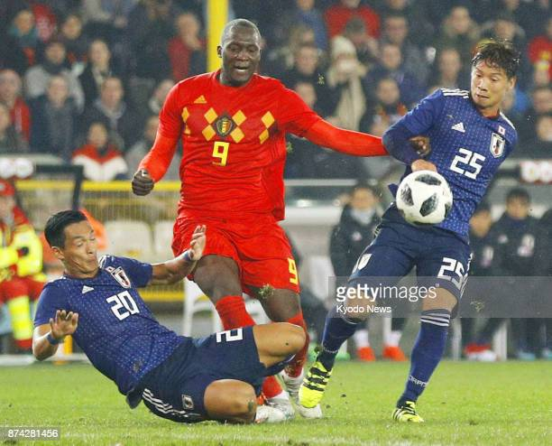 Japan's Tomoaki Makino and Kazuki Nagasawa halt Romelu Lukaku of Belgium during the first half of a 10 win over Japan in a soccer friendly in Bruges...