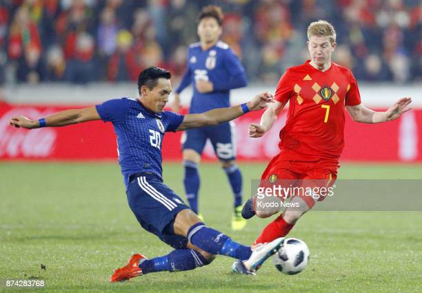 Japan's Tomoaki Makino and Kevin De Bruyne of Belgium vie for the ball during the first half of a soccer friendly in Bruges on Nov 14 2017 Belgium...