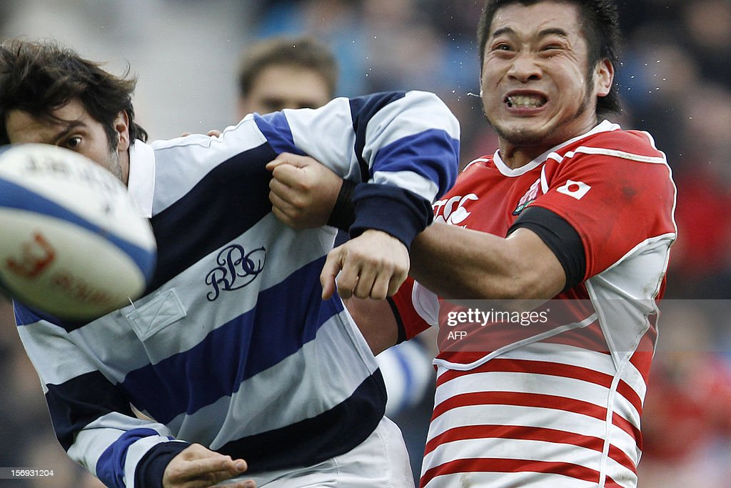 Japan's Tomohiro Senba fights for the ball with Barbarian's Jerome Fillol uring the Rugby Union exhibition match between Barbarian RC and Japan XV at Oceane Stadium, on November 25, 2012, in the northwestern city of Le Havre.