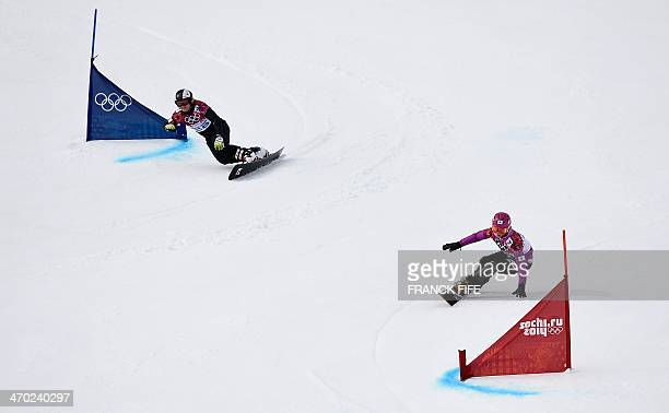 Japan's Tomoka Takeuchi and Italy's Corinna Boccacini compete in the Women's Snowboard Parallel Giant Slalom 1/8 Finals at the Rosa Khutor Extreme...