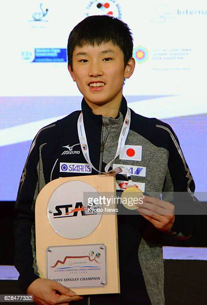 Japan's Tomokazu Harimoto holds a medal after winning the boys' singles at the world junior table tennis championships for players aged 18 and under...