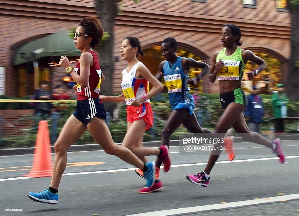 Japan's Tomomi Tanaka (L) leads a pack of runners, Japan's Reia Iwade (2nd L), Kenya's Philes Ongori (2nd R) and Kenya's <a gi-track='captionPersonalityLinkClicked' href=/galleries/search?phrase=Caroline+Rotich&family=editorial&specificpeople=14407354 ng-click='$event.stopPropagation()'>Caroline Rotich</a> during the Yokohama International Women's Marathon on November 16, 2014. Tanaka won the race with a time of 2 hours, 26 minutes and 57 seconds. AFP PHOTO / Yoshikazu TSUNO
