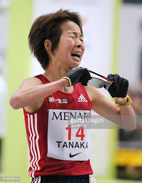 Japan's Tomomi Tanaka reacts after crossing the finish line in the Nagoya Women's Marathon on March 13 2016 / AFP / JIJI PRESS / JIJI PRESS / Japan...