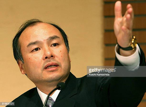 Japan's top Internet services provider Softbank president Masayoshi Son speaks during a press conference on November 30 2004 in Tokyo Japan Softbank...