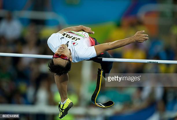 Japan's Toru Suzuki competes in the men's high jump T44 final in the Olympic Stadium during the Paralympic Games in Rio de Janeiro Brazil on...