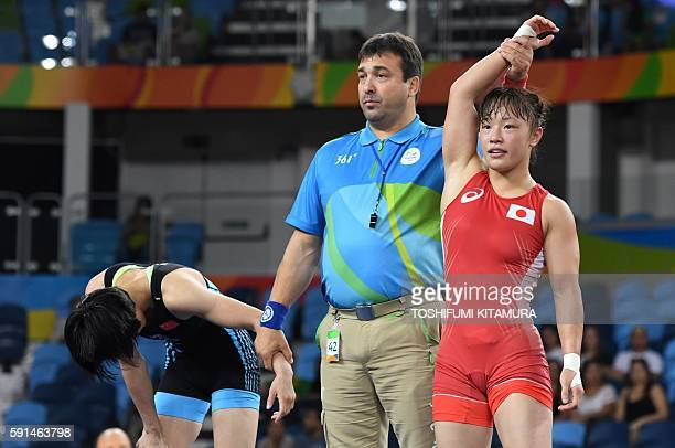 Japan's Tosaka Eri celebrates winning against China's Sun Yanan in their women's 48kg freestyle semifinal match on August 17 during the wrestling...