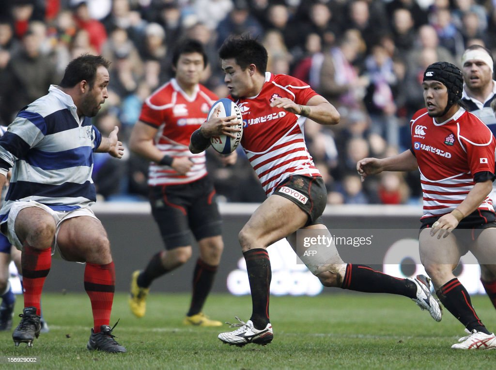 Japan's Toshiaki Hirose (C) makes a break during the Rugby Union exhibition match between Barbarian RC and Japan XV at Oceane Stadium, on November 25, 2012, in the northwestern city of Le Havre.