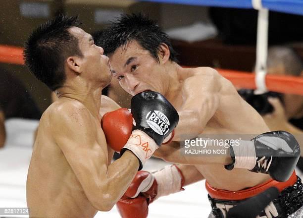 Japan's Toshiaki Nishioka connects with a left against Napapol Kiatisakchokchai of Thailand during their WBC superbantamweight title bout in Yokohama...