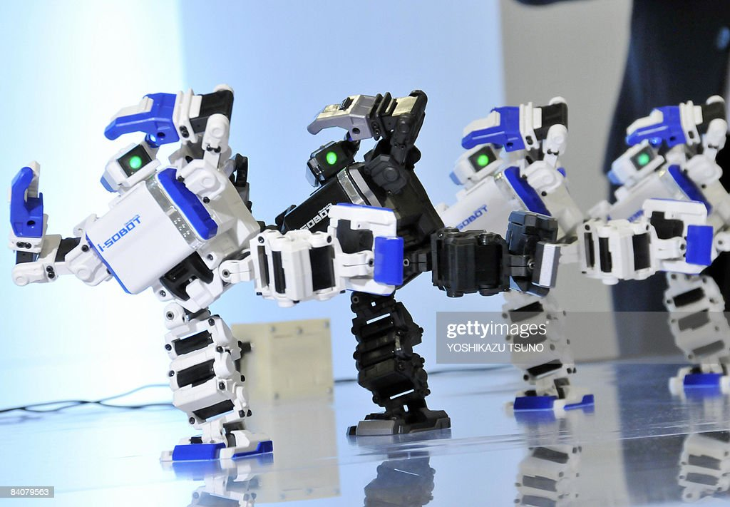 Japan's toy giant Tomy displays the world's smallest humanoid robot 'i-Sobot', which is 165mm in height, weighing 350g and equipped with 17 micro actuators and a gyro-sensor as it dances in Tokyo on December 18, 2008. The i-Sobot received the government sposored robot award for this year in Tokyo on December 18. AFP PHOTO / Yoshikazu TSUNO