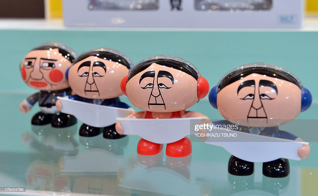 Japan's toy maker Dreams Come True displays 'SwingPets Abebot' doll toys depicting Prime Minister Shinzo Abe and his party LDP Secretary General Shigeru Ishiba (L) at the annual International Tokyo Toy Show in Tokyo on June 13, 2013. Some 150 Japanese and foreign toy makers are exhibiting their latest products at the four day trade show. AFP PHOTO / Yoshikazu TSUNO