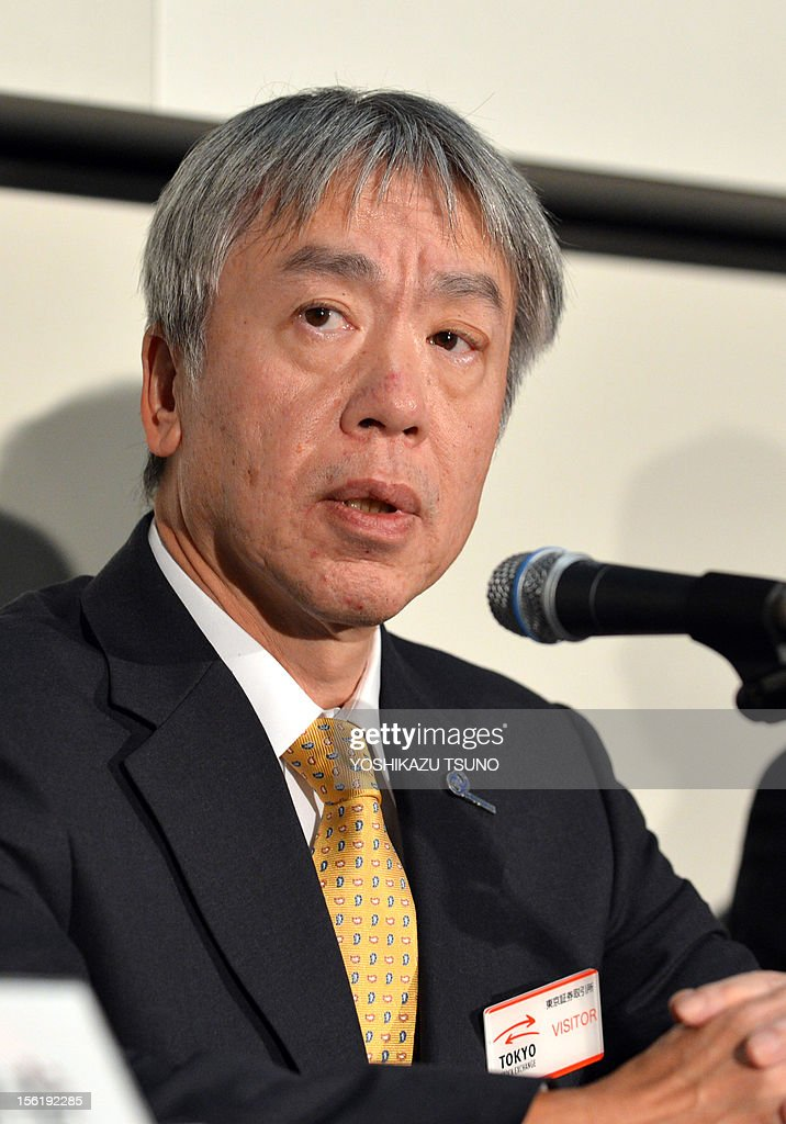 Japan's troubled optical giant Olympus President Hiroyuki Sasa announces the company's first half financial result ended September at the Tokyo Stock Exchange on November 12, 2012. Olympus said on November 12 it had swung to a 100 million USD first-half profit, reversing a year-earlier loss, as the camera and medical equipment maker moves on from an embarrassing accounting scandal. AFP PHOTO / Yoshikazu TSUNO