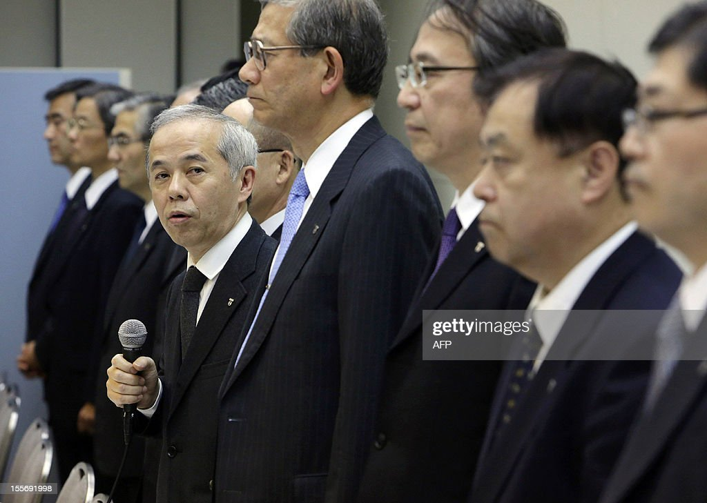 Japan's troubled Tokyo Electric Power Co (TEPCO) president Naomi Hirose, accompanied by the company executives, spaeks at a press conference at the company's headquarters in Tokyo on November 7, 2012. The cost of the clean-up and compensation after Japan's Fukushima nuclear disaster may double to 125 billion USD, TEPCO said.