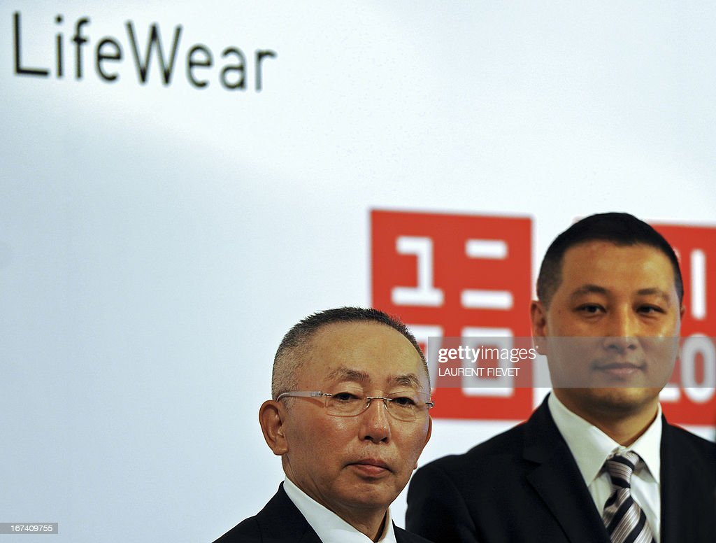 Japan's UNIQLO chairman and CEO Tadashi Yanai (L) and its Hong Kong managing director Pan Ning attend a press conference in Hong Kong on April 25, 2013. UNIQLO will open its newest global store in Hong kong on April 26, following its success in greater China with more than 200 stores.
