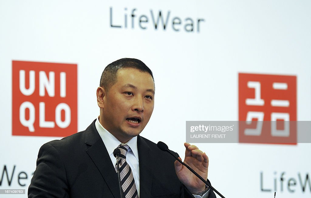Japan's UNIQLO Hong Kong managing director Pan Ning addresses a press conference in Hong Kong on April 25, 2013. UNIQLO will open its newest global store in Hong kong on April 26, following its success in greater China with more than 200 stores. AFP PHOTO / LAURENT FIEVET