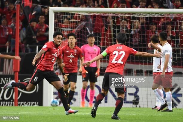 Japan's Urawa Red Diamonds' Rafael Da Silva runs to celebrate with teammate Yuki Abe after scoring during the Asian Champions League semifinal...