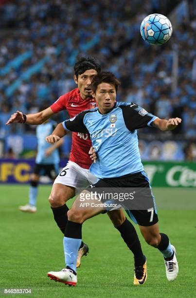 Japan's Urawa Reds defender Ryota Moriwaki fights for the ball with Kawasaki Frontale defender Shintaro Kurumaya during the AFC Champions League...
