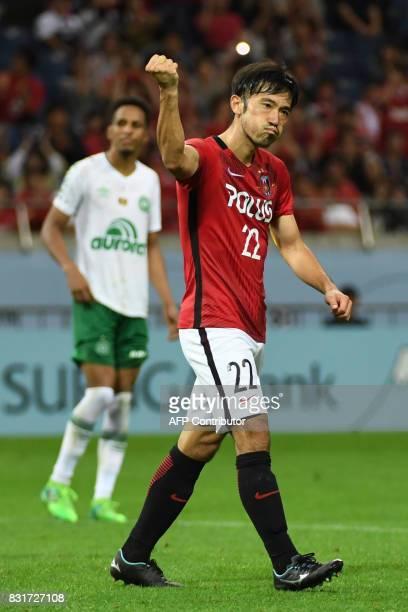 Japan's Urawa Reds midfielder Yuki Abe celebrates converting a penalty kick during their football friendly match against Brazil's Chapecoense FC in...
