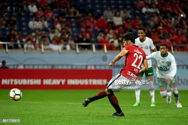 Japan's Urawa Reds midfielder Yuki Abe scores from the penalty spot during their football friendly match against Brazil's Chapecoense FC in Saitama...