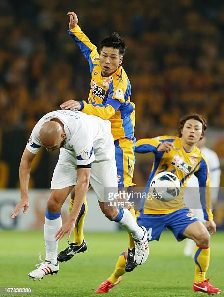Japan's Vegalta Sendai forward Atsushi Yanagisawa competes for the ball against China's Jiangsu Sainty defender Eleilson during their AFC Champions...